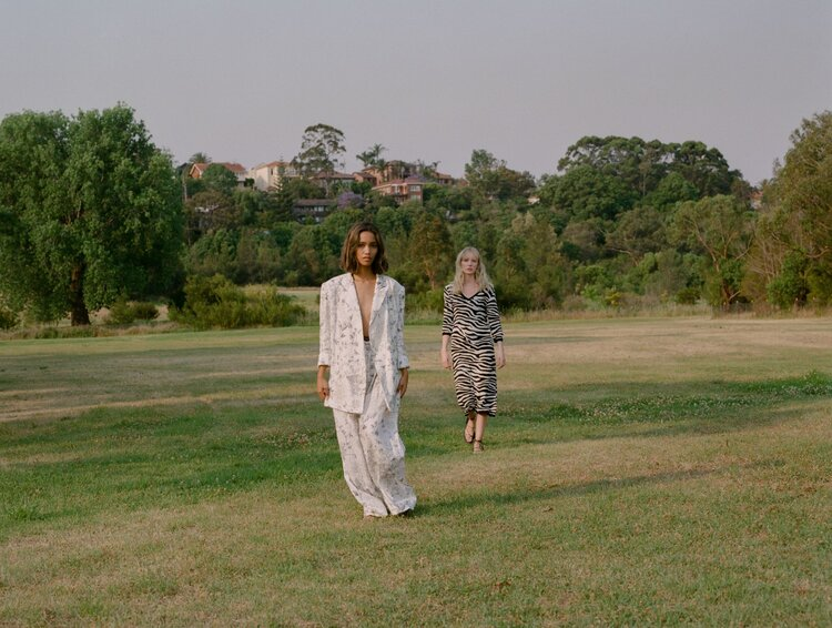 Khai wears Leo & Lin suit, Zhon wears Kate Sylvester dress. Both girls wear Maria Farro sandals. Shot on film by Aaron VIII