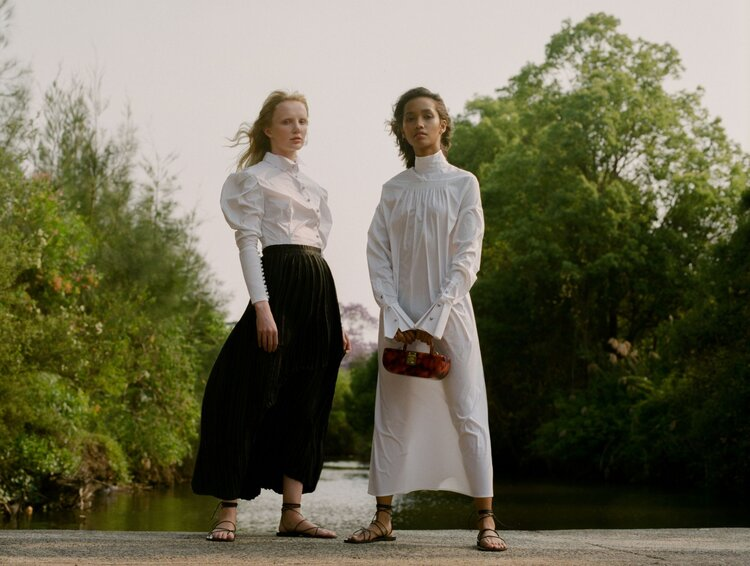 Khai wears Leo & Lin dress and Sans Beast bag. Zhon wears Leo & Lin shirt and Pleats Please by Issey Miyake skirt. Both girls wear Maria Farro sandals. Shot on film by Aaron VIII