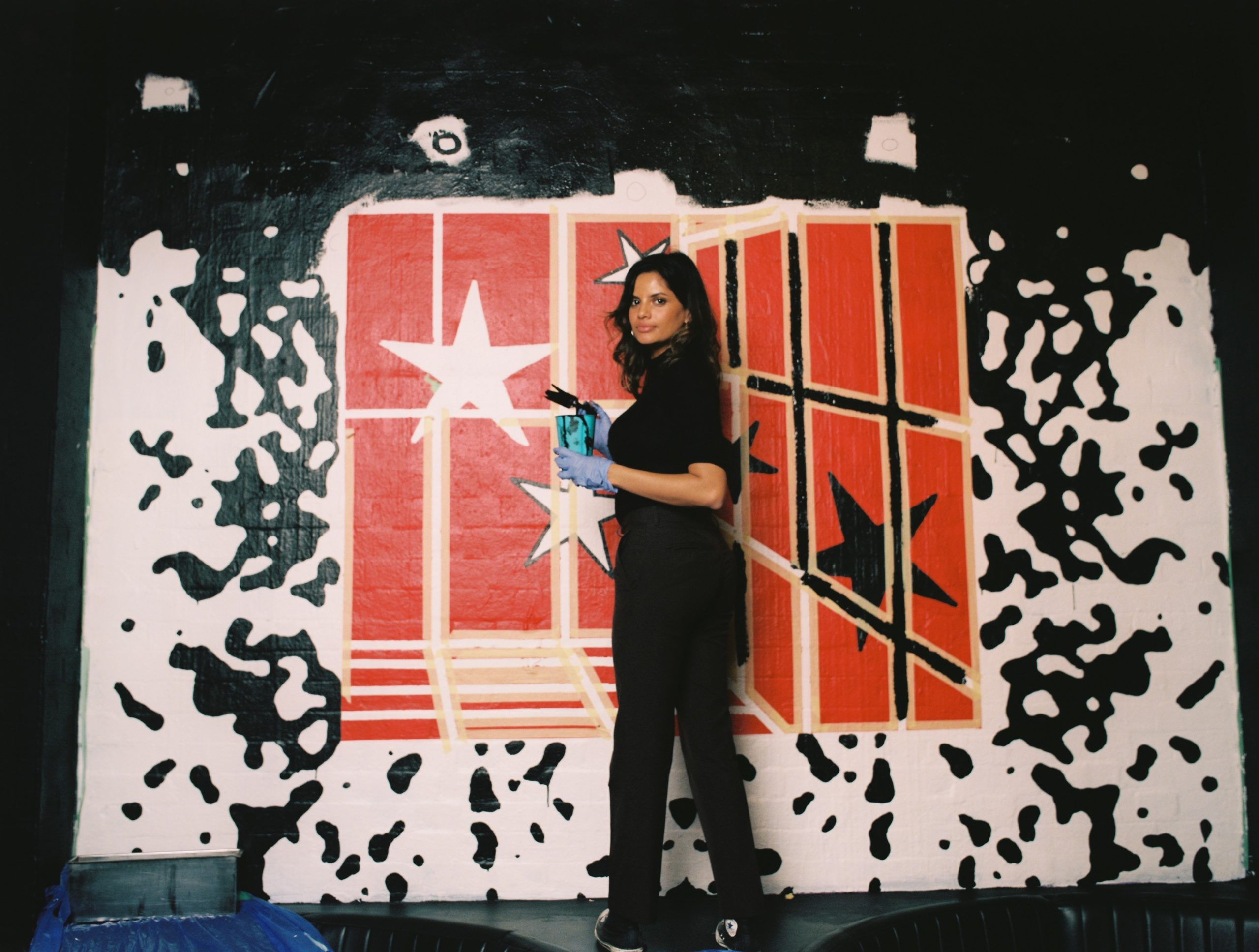 Joanne Frank painting her Madrasmade mural in Sydney's Oxford Art Factory shot on medium format film by Aaron VIII