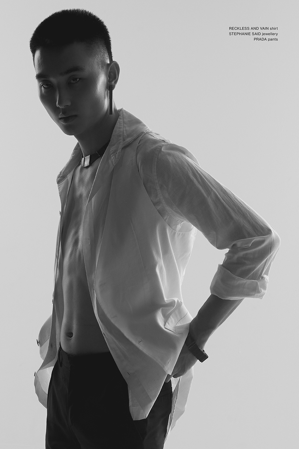 Bozhen wearing Prada, Reckless & Vain and Stephanie Said jewellery for Astrophe Homme fashion editorial by Aaron VIII